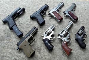 Clockwise starting at topleft:  Glock G22, Glock G21, Kimber Custom Raptor, Dan Wesson Commander, Smith & Wesson Air Weight .357, Ruger Blackhawk .357, Ruger SP101, Sig Sauer P220 Combat. Photo by: Joshuashearn