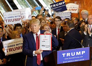 Donald Trump signing loyalty pledge. Photo by Michael Vadon